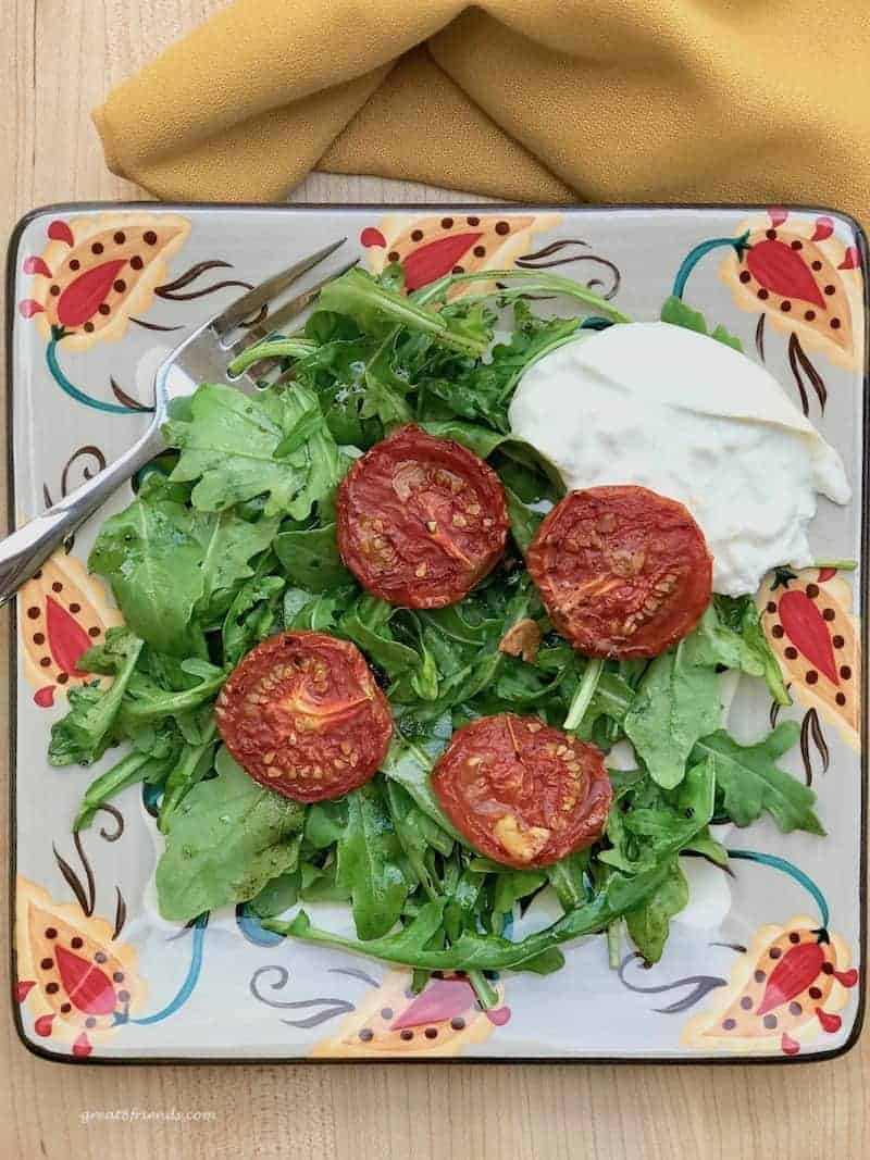 Roasted Tomato and Arugula Salad with a serving of burrata.
