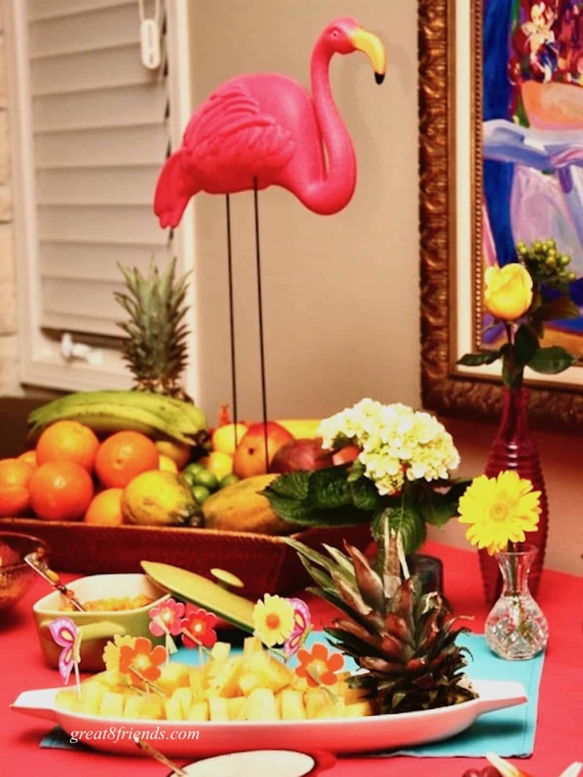 Appetizer table with pink flamingo centerpiece.