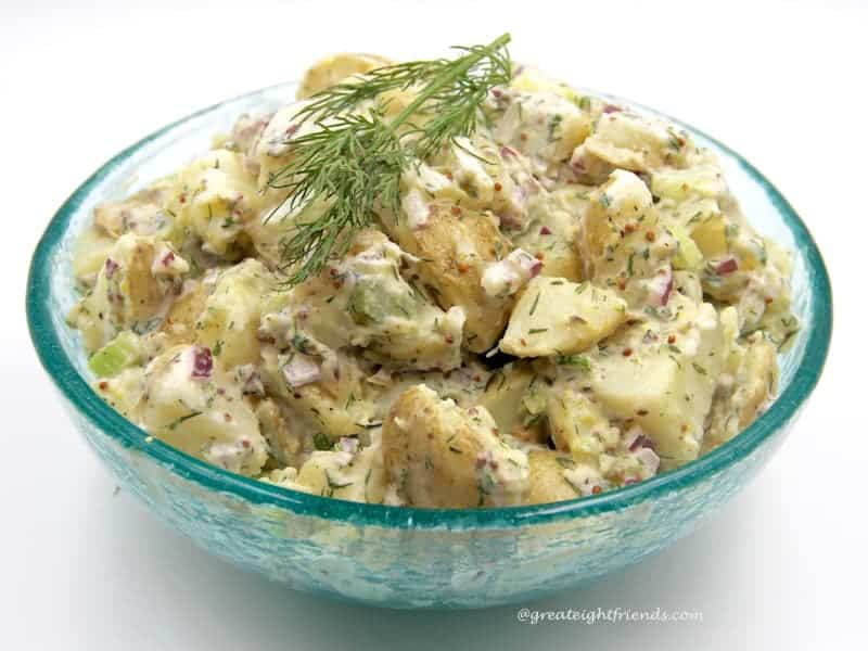 Fourth of July Food - a blue glass bowl filled with Dill potato salad.
