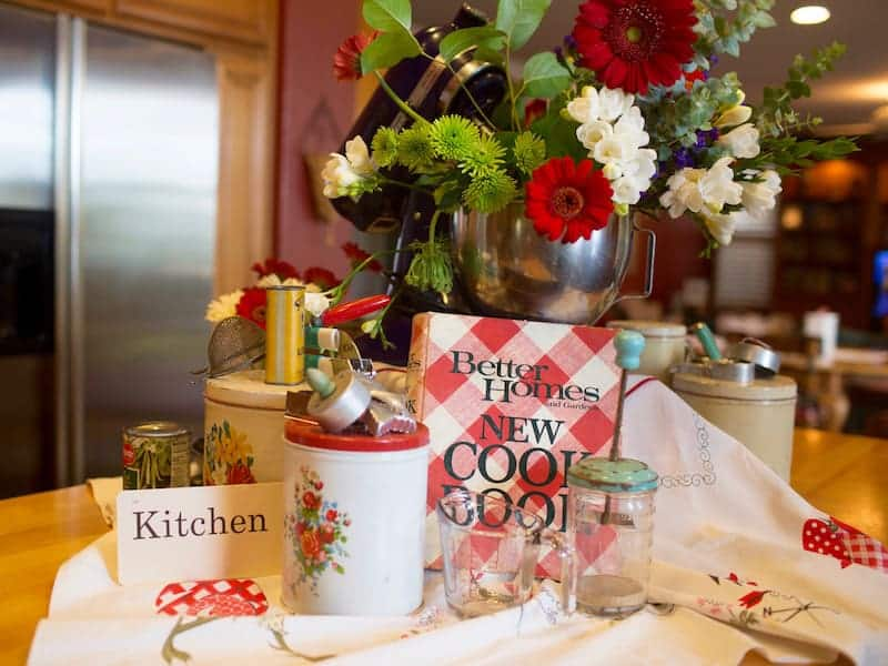 Memories from our Mother's Kitchen Island decor, vintage kitchen ware and a Better Home red and white cookbook.