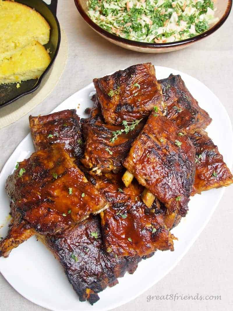 Barbecue Sauce on grilled pork ribs served with kale coleslaw and cornbread.