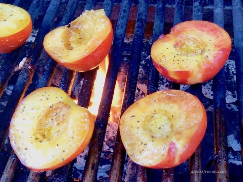 Nectarine halves on a fired up grill.