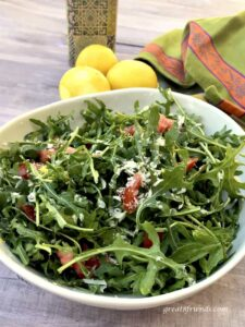 Arugula Salad served with Lemon Parmesan Dressing.