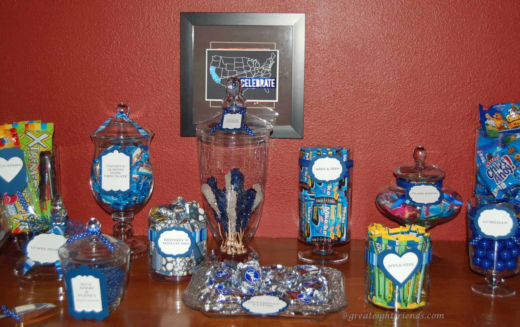 """""""Candy bar"""" on a counter. Different candies in blue tones on a counter with some in glass jars."""