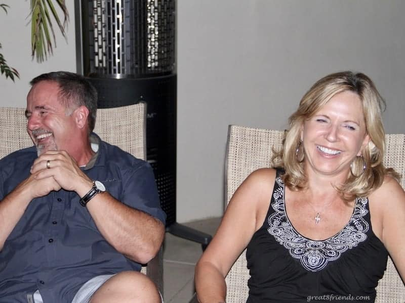 A man and a woman laughing.
