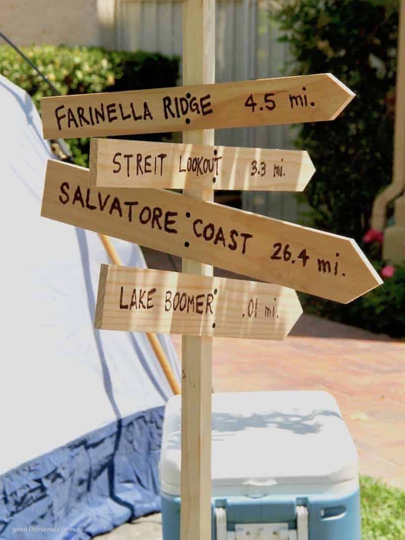 Four wood signs used as a decoration for the camping themed dinner party.