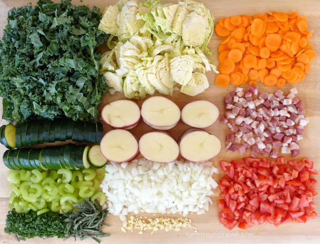 Vegetables chopped and arranged on a wooden board.
