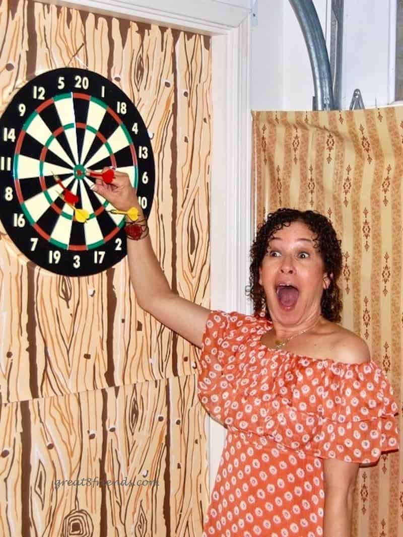 Debbie so happy after she won the dart game.