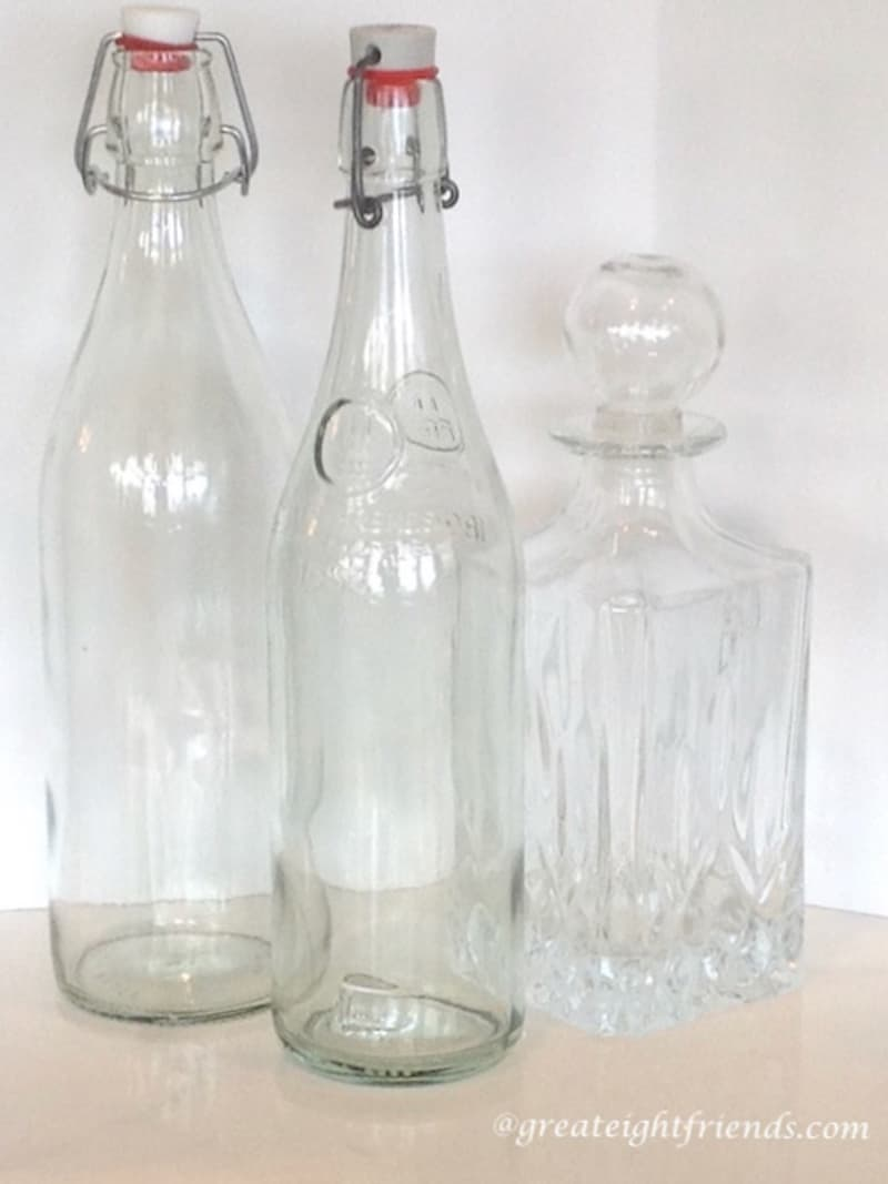 3 empty glass bottles.