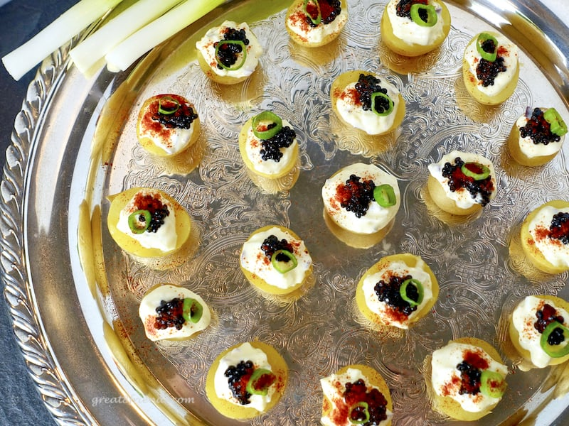 This Caviar with Cream on Baby Potatoes is an elegant and easy way to serve caviar to a crowd. A small bite without the assembly mess!