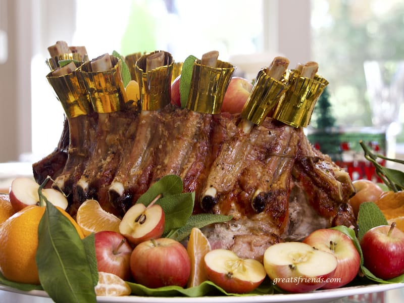 Crown Roast of Pork surrounded by apples and tangerines, horizontal