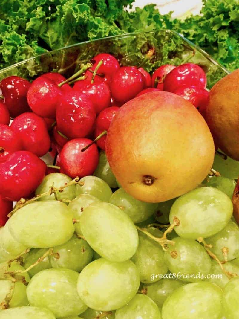 Close up of fruit, cherries, pear, and grapes.