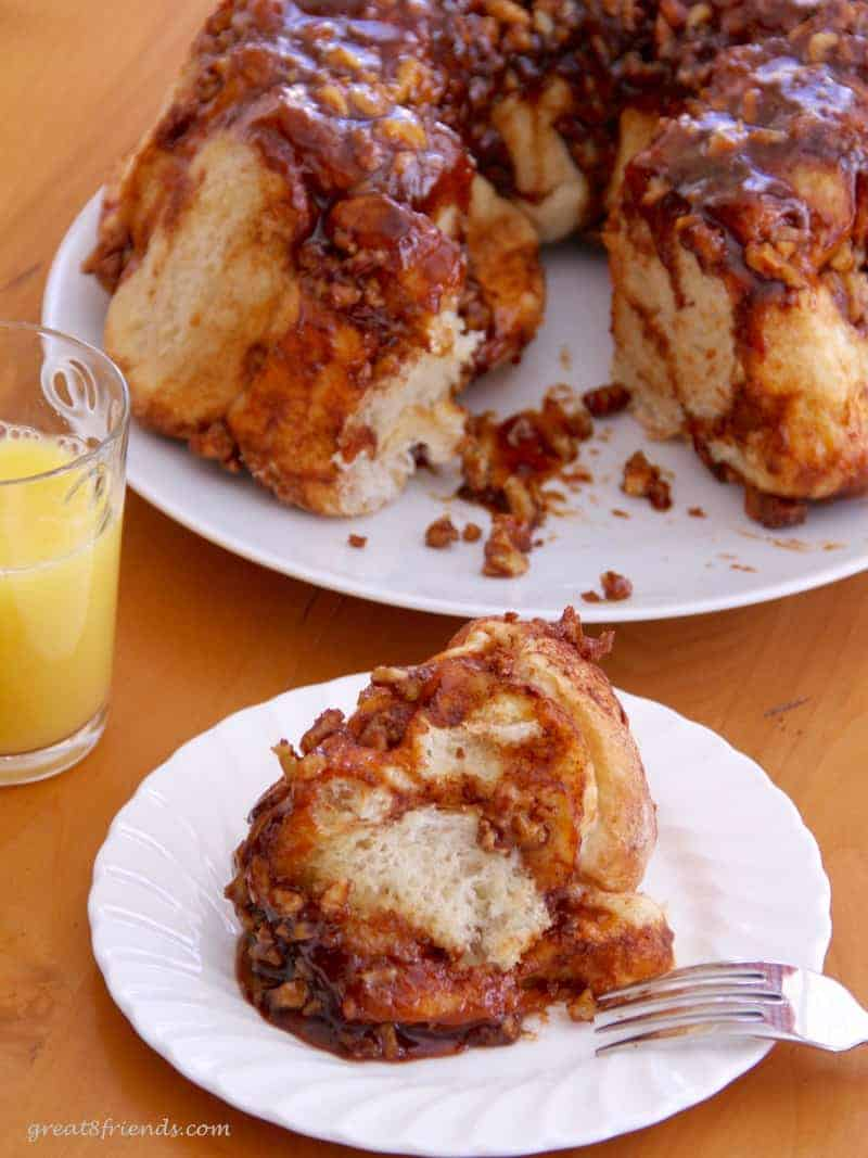 A cut piece of easy sticky buns (monkey bread) for served for breakfast.