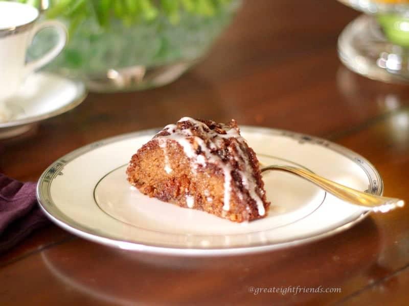 Cut piece of Cinnamon Coffee Cake on a plate.