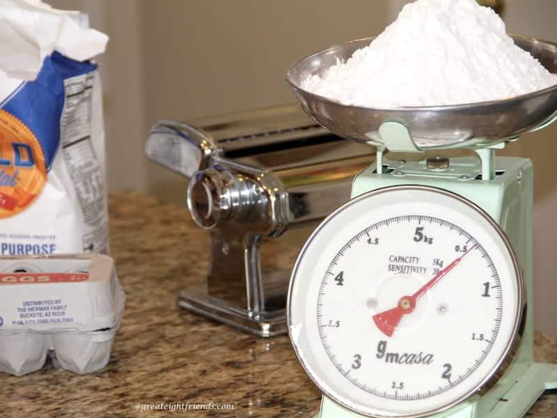 Measuring flour on a scale.