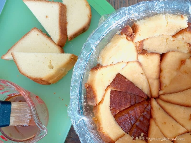 Pound cake in bowl arranged as first layer in bowl.