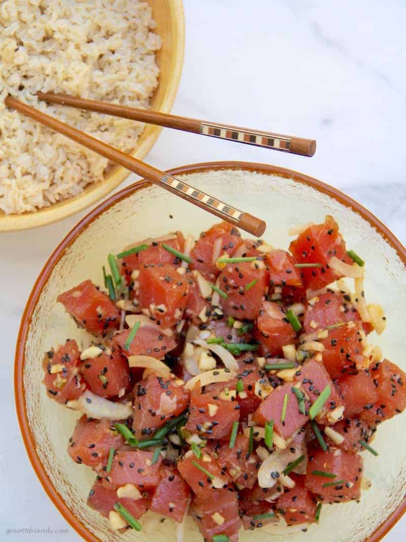 Large bowl of ahi poke with another bowl of brown rice.