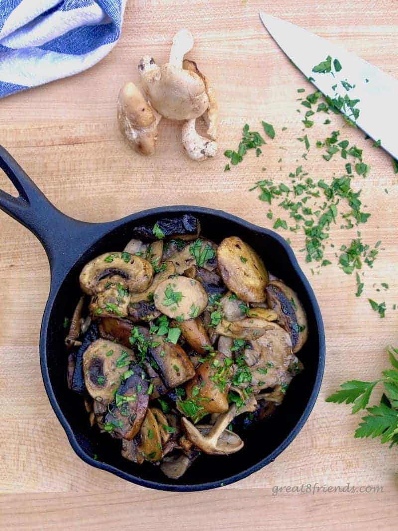 Mushrooms in Garlic Sauce in cast iron skillet.