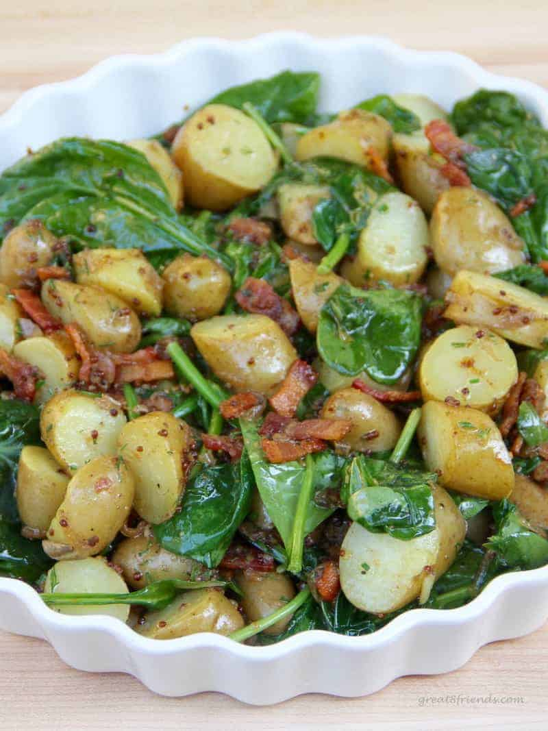 Up close view of Warm Spinach Potato Salad with Bacon Vinaigrette.