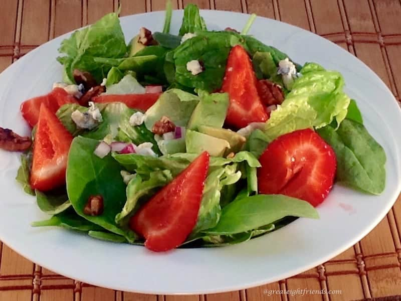 Strawberry Summer Salad with avocado blue cheese and walnuts