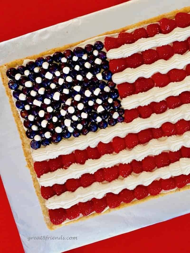 Step it up with this American Flag Fruit Pizza for your 4th of July festivities. It's a cookie crust with cheesecake mousse - FIREWORKS!!
