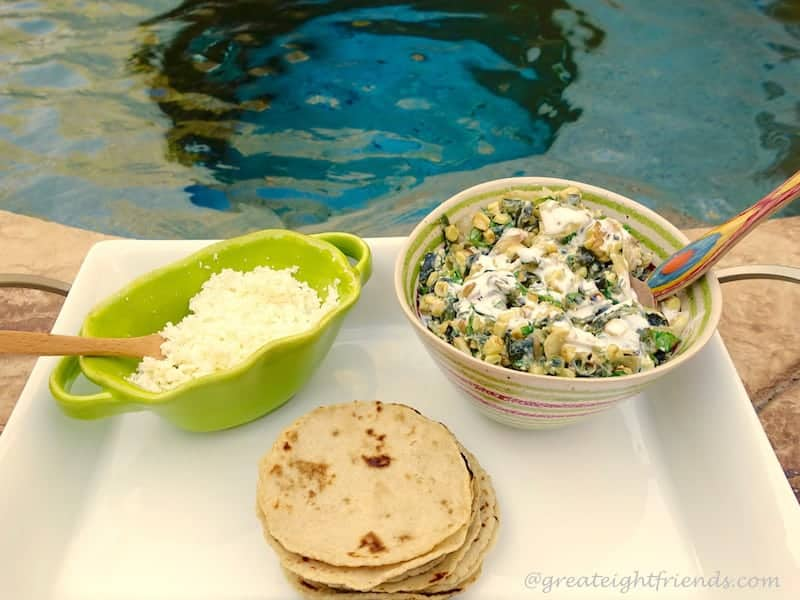 Tortillas and filling on a tray in front of a pool.