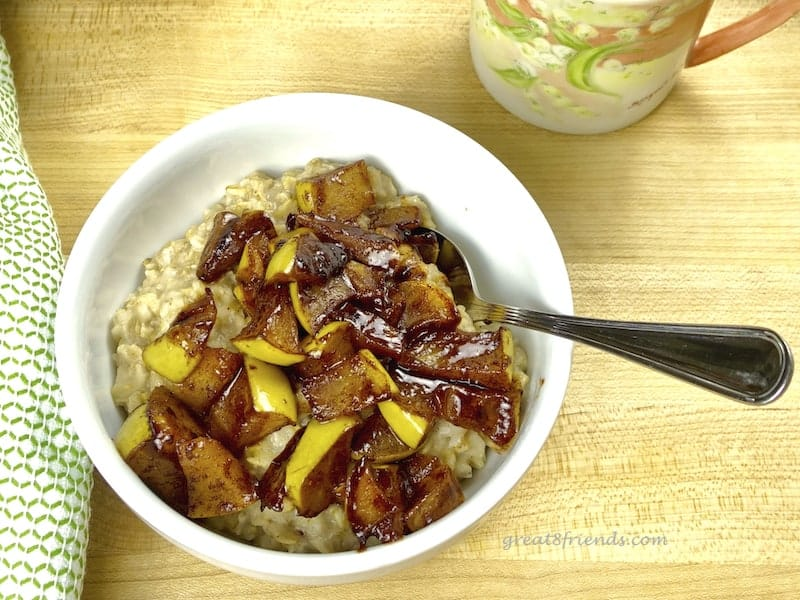 Apple Pie Oatmeal in bowl with spoon.