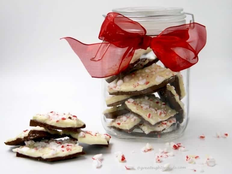 White and chocolate candy in a jar and wrapped as a gift.