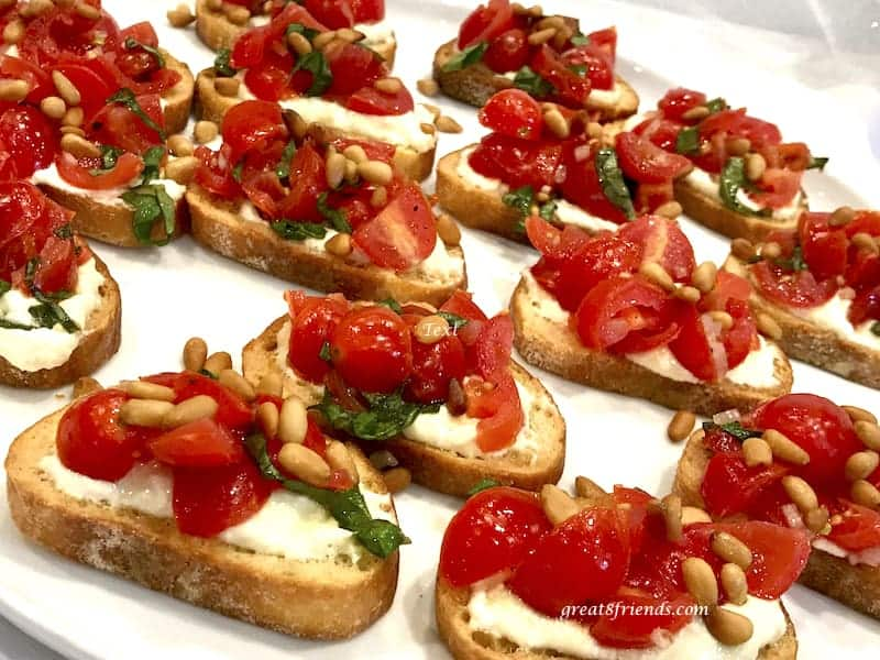 Tomato Crostini lined up ready to serve.