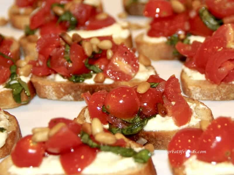 Close up photo of several tomato crostini.