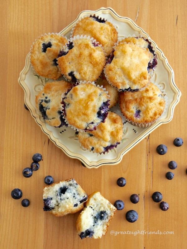 Overhead shot of square plate filled with Blueberry Muffins.