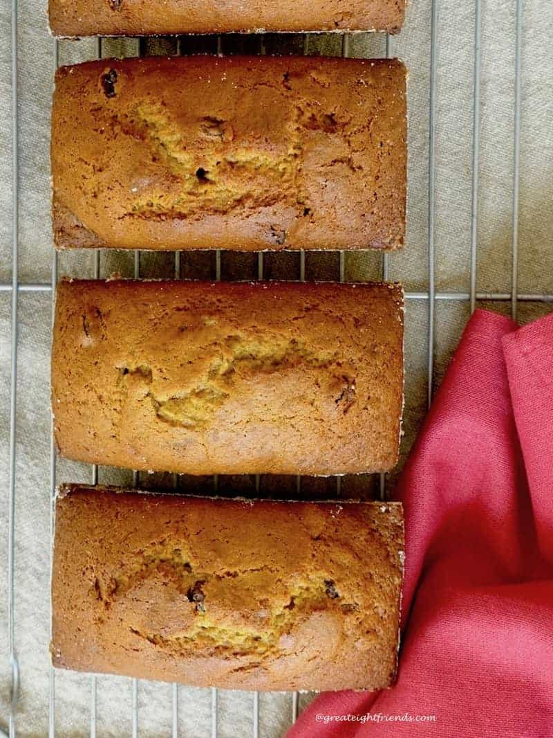 overhead shot of 3 loaves of Roasted Pumpkin Olive Oil Quick Bread