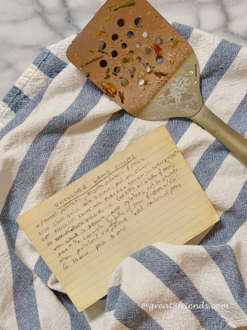 photo of old recipe card, dish towel and spatula.