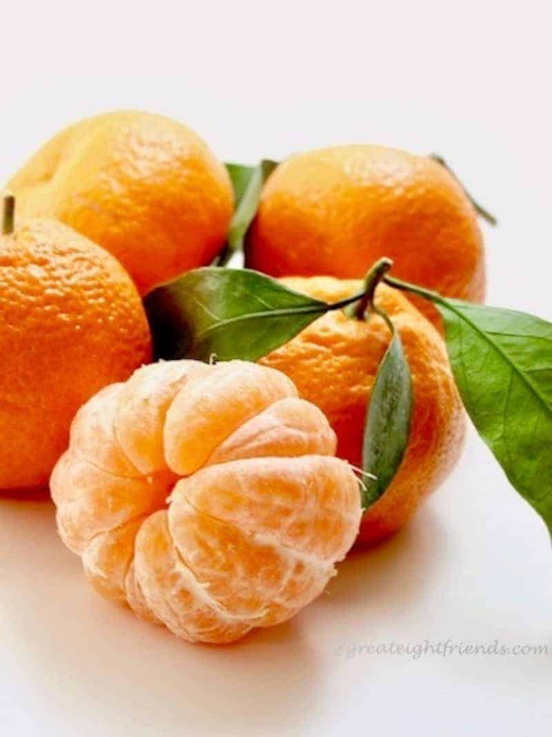 Fresh Tangerines, one is peeled.