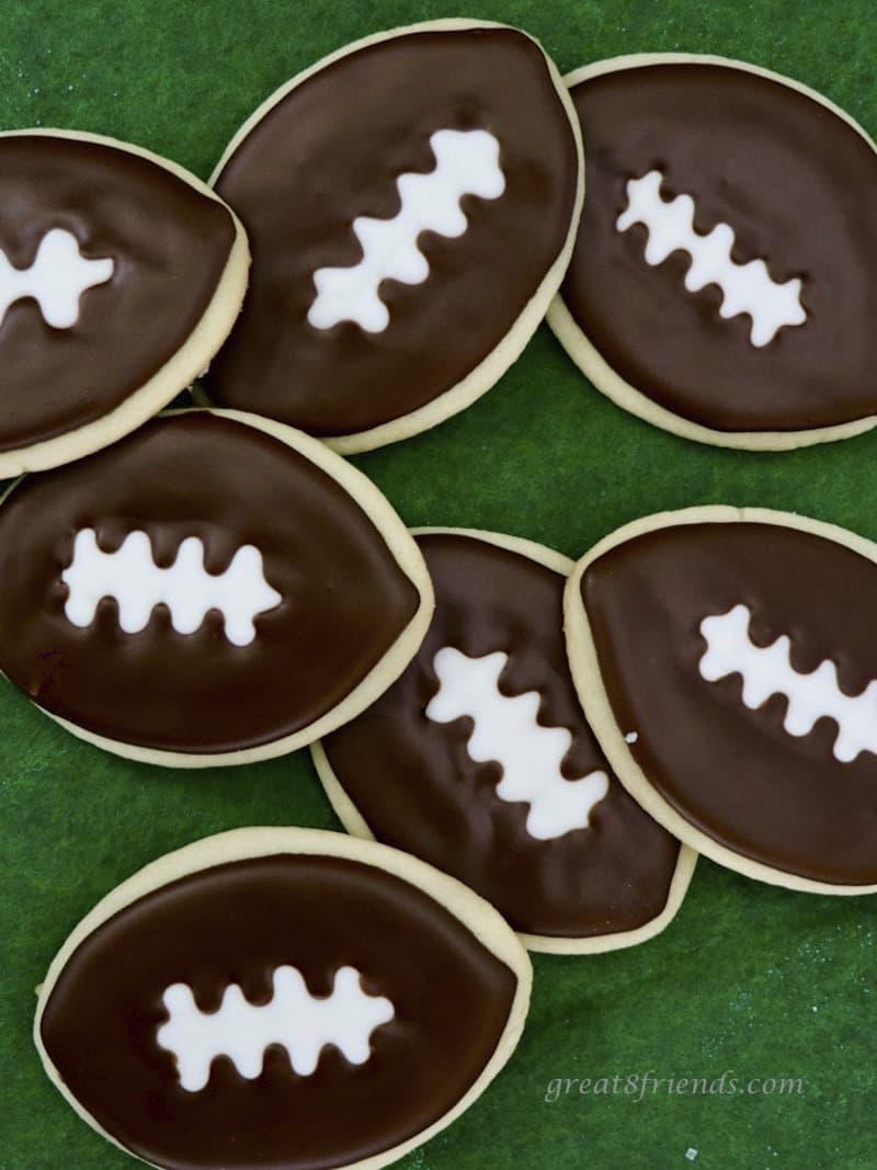 Football Cookies on green felt.
