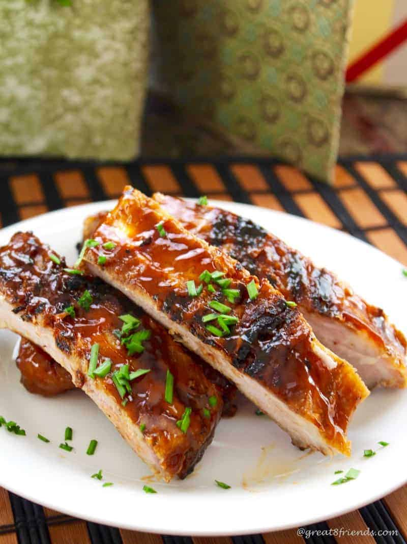 Chinese Style Ribs stacked on a white plate.