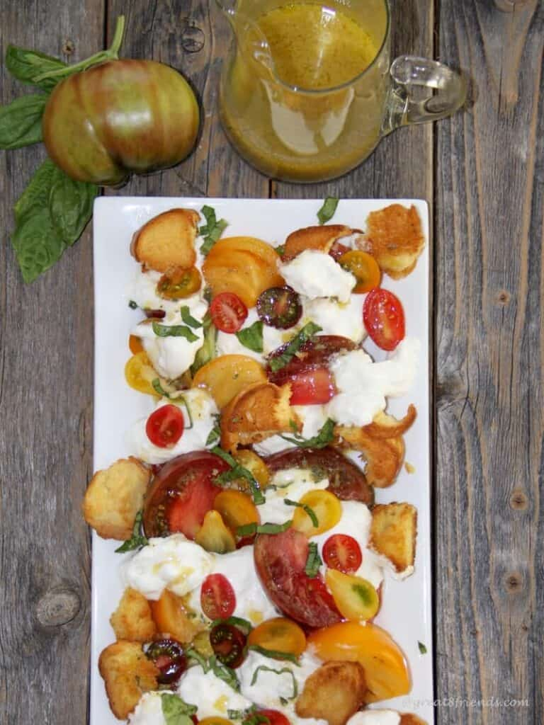 Change up your everyday green salad with this heavenly Tomato Burrata Salad with a flavorful vinaigrette and simple homemade croutons!