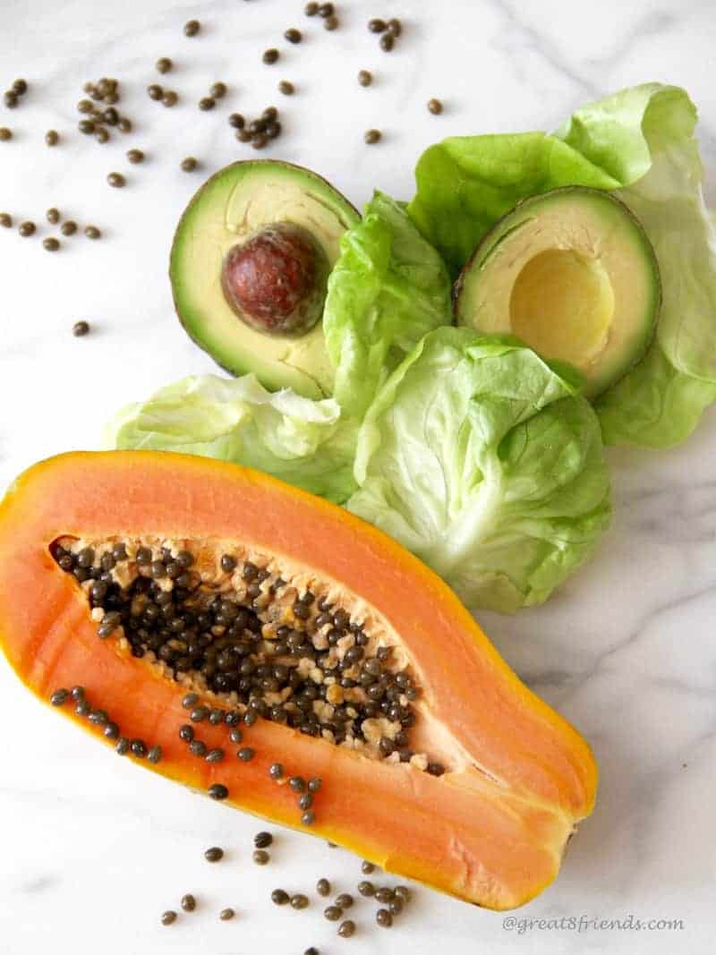 This Papaya and Avocado salad is fresh and simple to make! The dressing includes the papaya seeds which adds a delicious peppery mustard flavor.