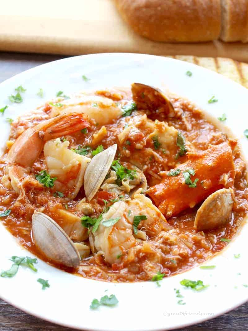 Attention seafood lovers! Enjoy this delicious Cioppino, a hearty seafood stew. It is a fish stew chock full of your favorite seafood and flavors.