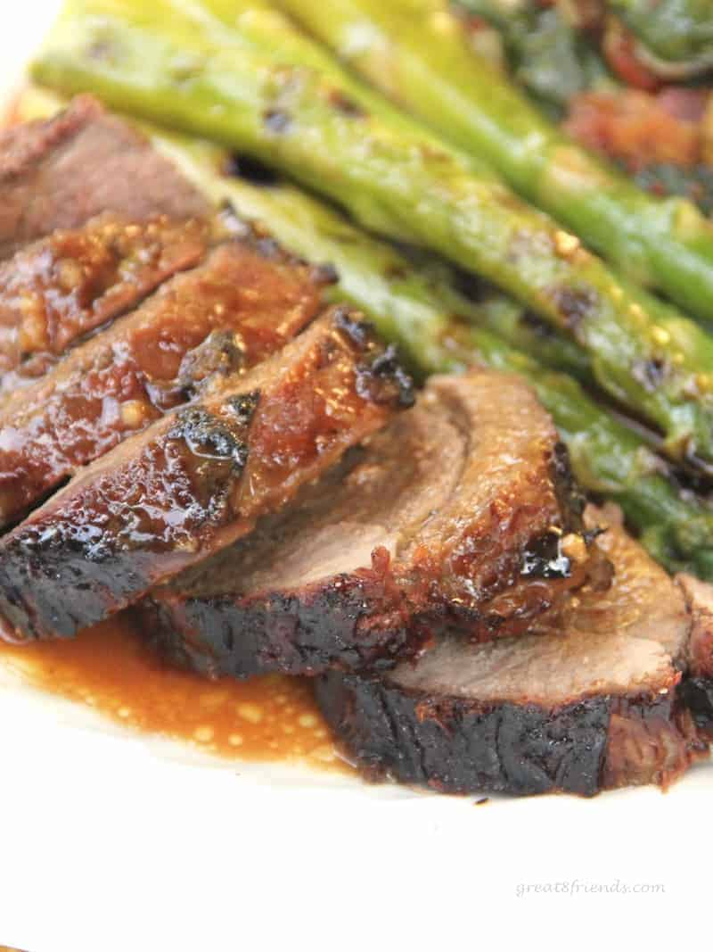 This grilled butterflied and marinated leg of lamb is unbelievably delicious. The warmed marinade can be added to the lamb on the plate. A crowd pleaser meal!