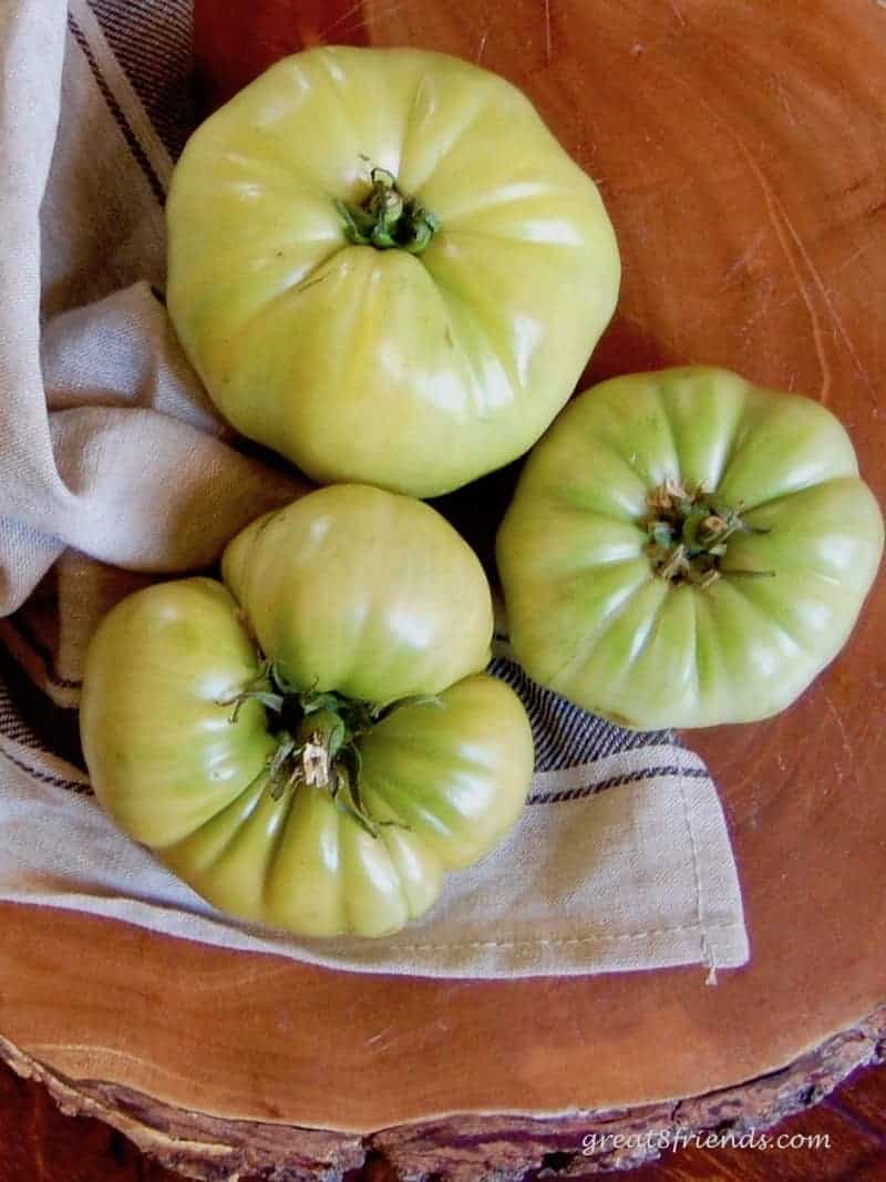 Three whole green tomatoes.