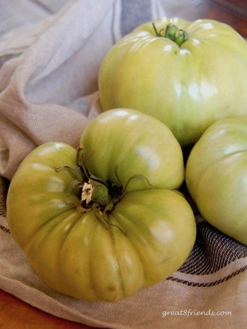 Whole green tomatoes.