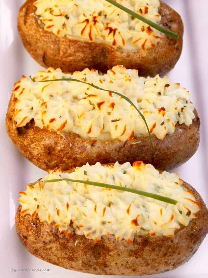 These twice baked potatoes include a creamy filling with goat cheese and scallions and twice baked creating a crisp outside shell.