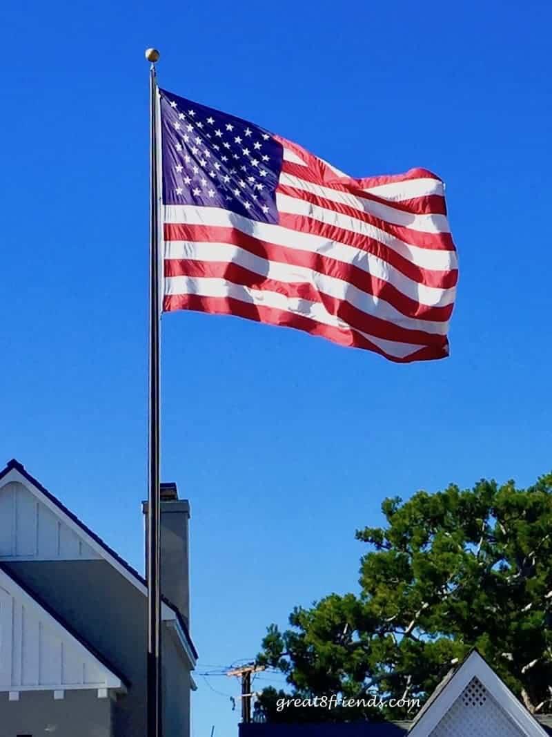 American Flag on a pole against a blue sky.