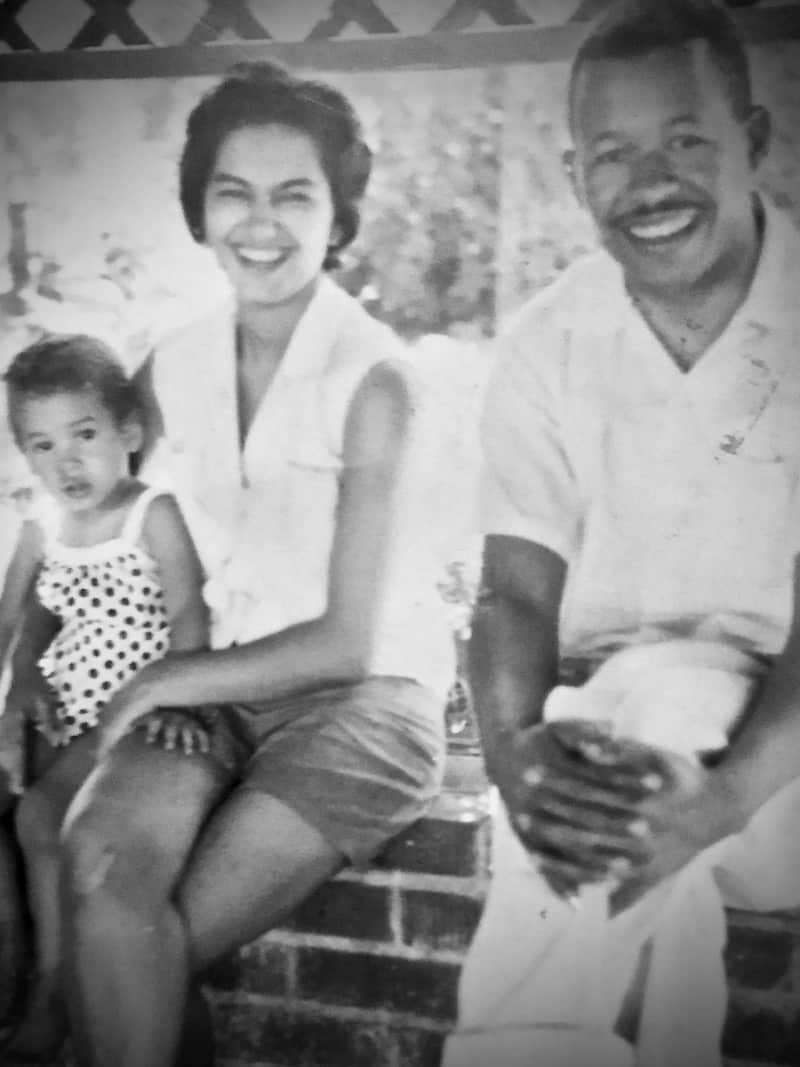 Black and white photo of an African American family of three.