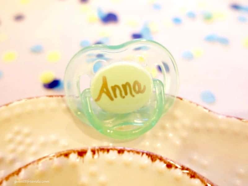 Unclose baby pacifier with the name Anna written on the base.