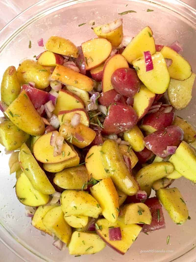 Cut up and seasoned potatoes.