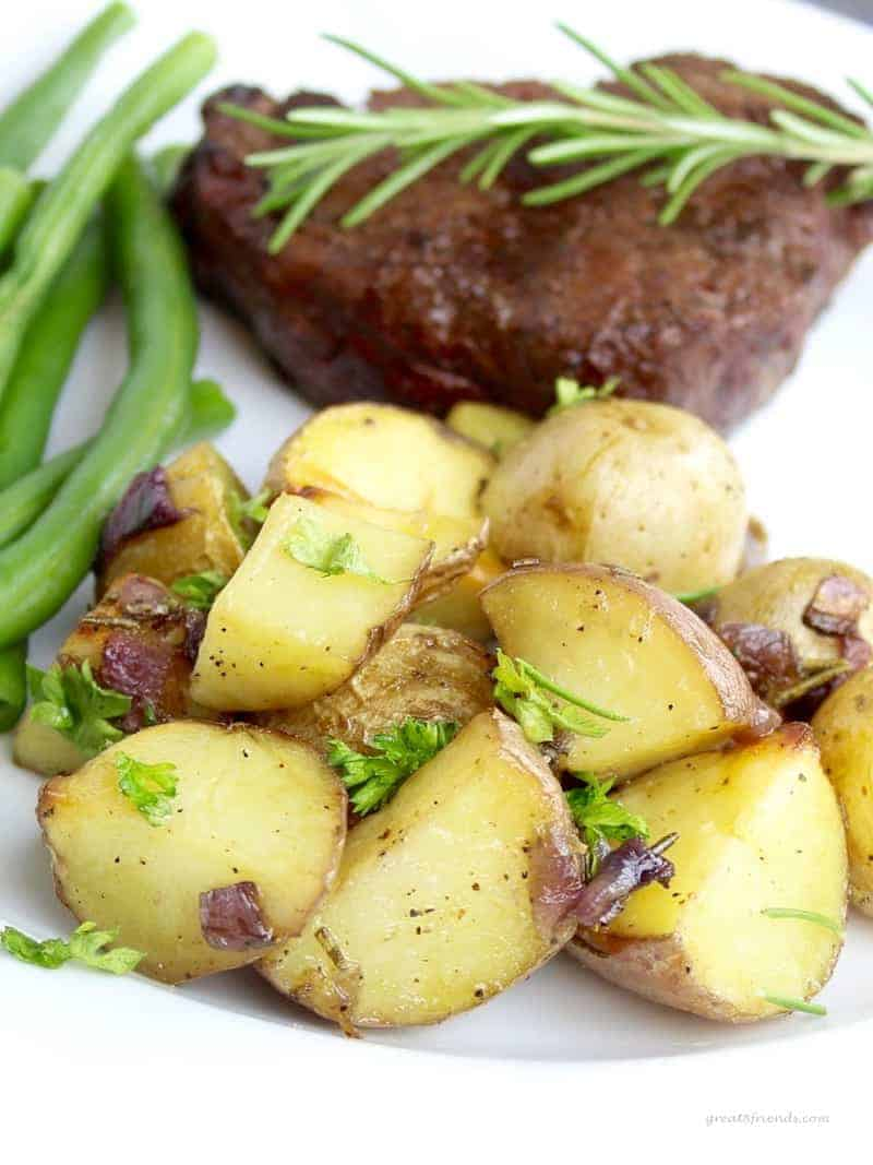 Roasted Herbed Baby Potatoes with steak and green beans.
