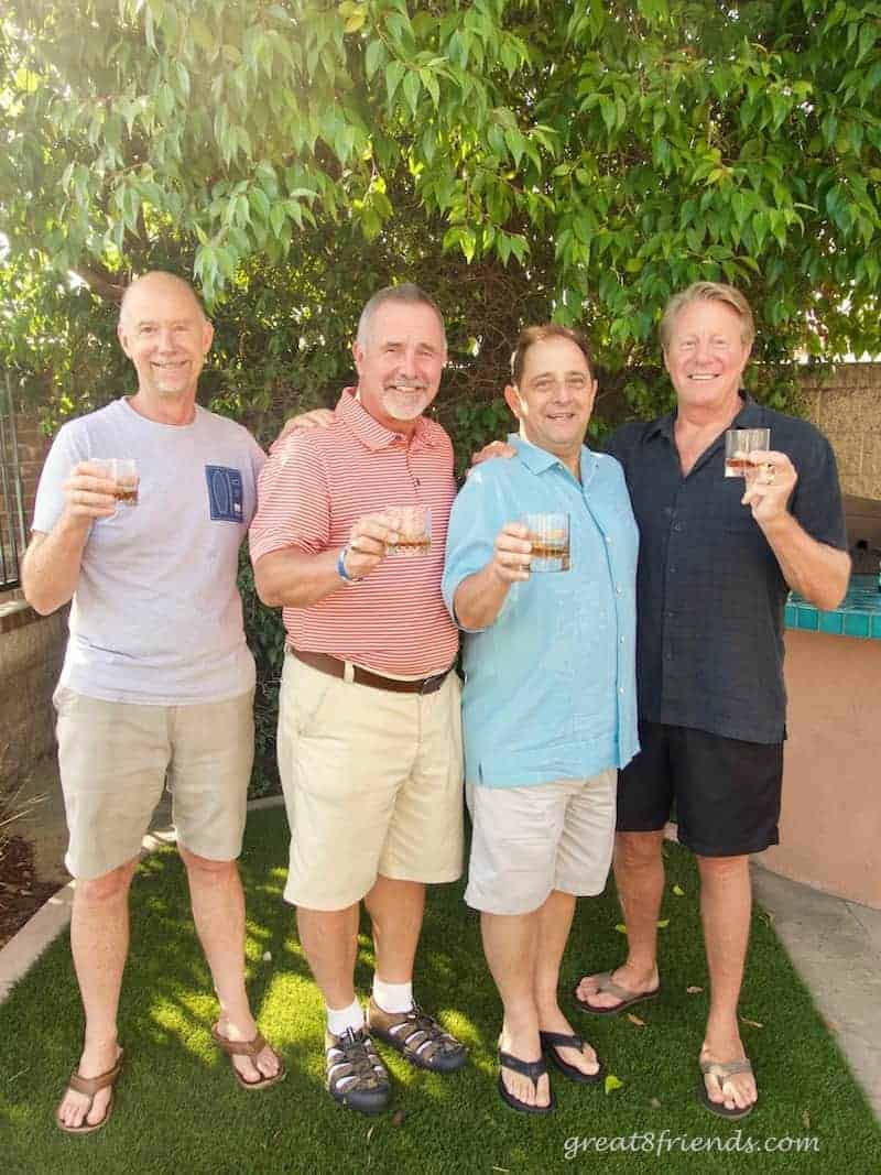 4 men toasting with cocktail glasses, gr8 gifts for guys.