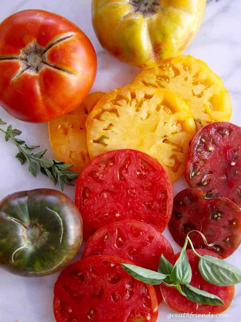 Unclose photo of fresh cut heirloom tomatoes.